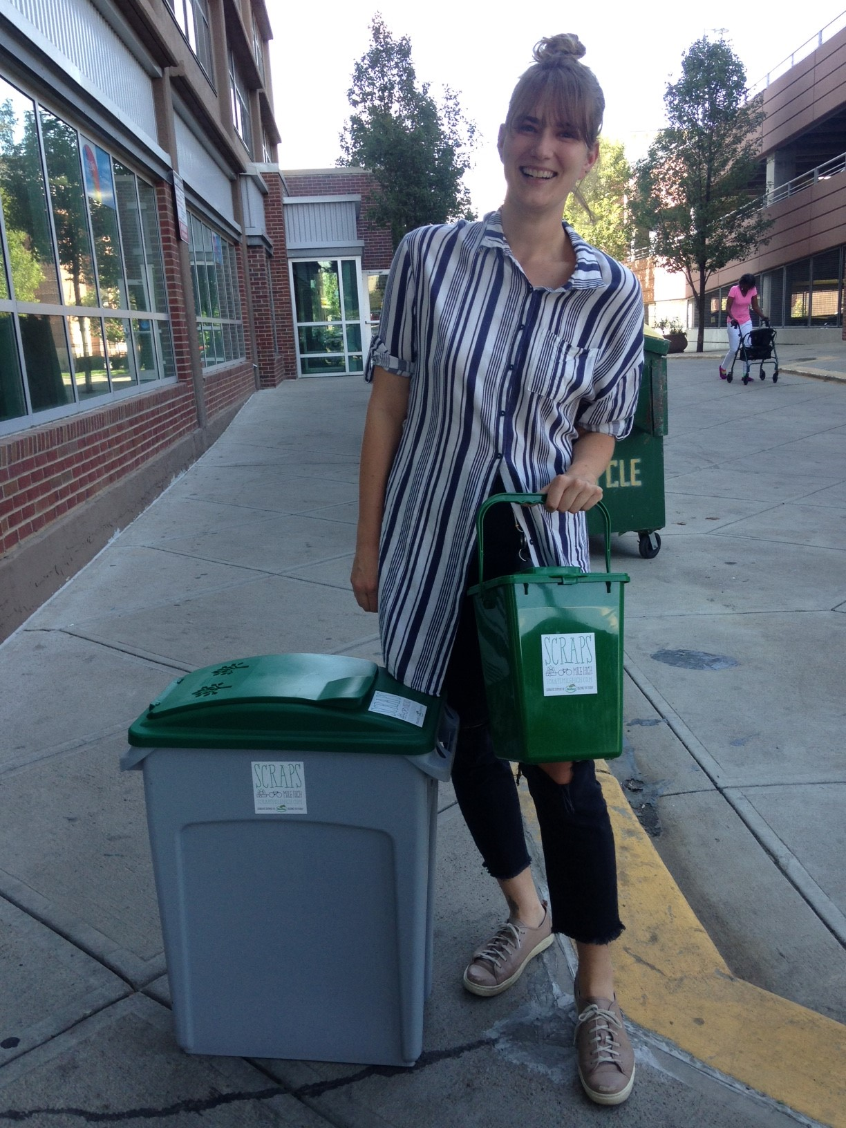Our Scraps collection bin, standing beside Amy.