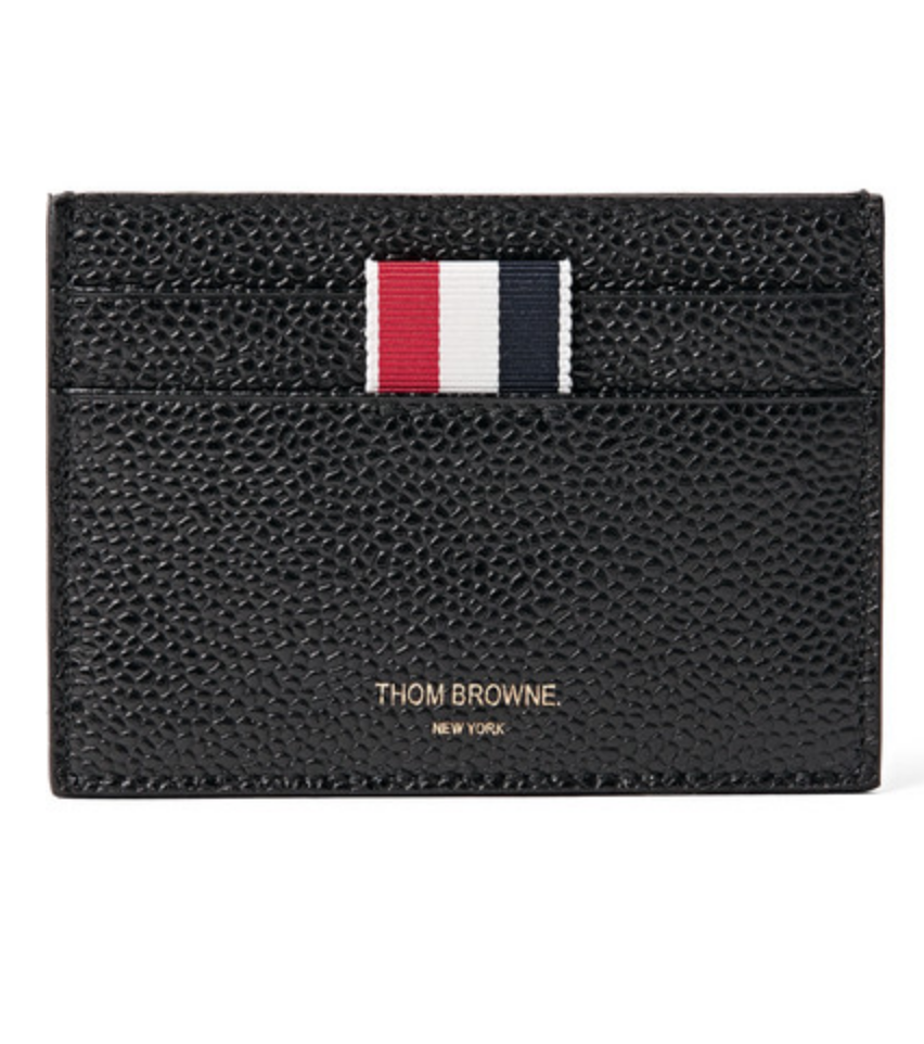 $290 - Thom Browne leather cardholder   Simple yet elegant. Thom Browne's pebbled leather cardholder is gorgeous. I don't think anyone would be mad if they received this!!