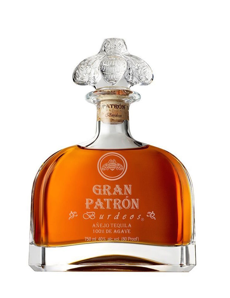 $510 - Gran Patrón Burdeos   The perfect luxury gift for any tequila lover! This Gran Patrón Burdeos is probably one of the most unique tequilas I've ever tried! It's a luxury añejo finished and aged in Bordeaux wine barrels. The bottle is also gorgeous! DM me and I'll send you my address ;)