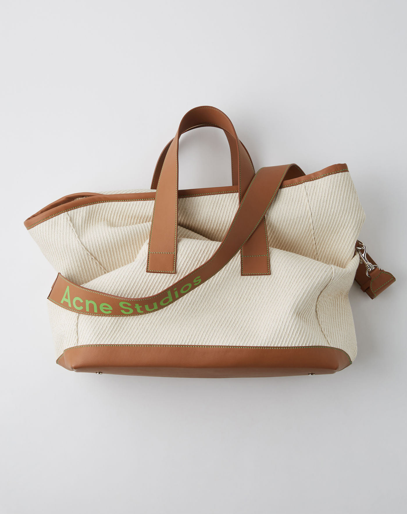 $1200 - Acne weekender bag   I love a great weekend bag and I love the classic beige and light brown colors with a pop of that Acne lime green! The perfect combo of classic and contemporary!