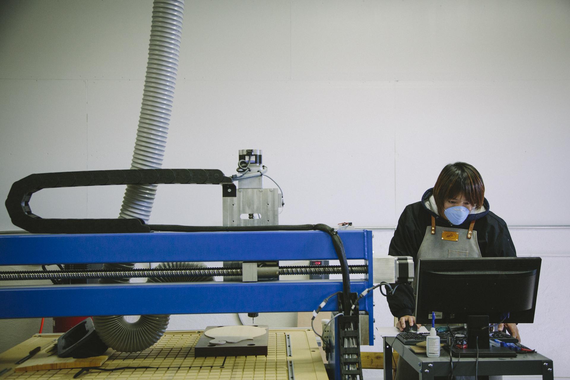 Acoustic designer, Kosuke Kyomori carving a prototype top in the Marshall workshop.