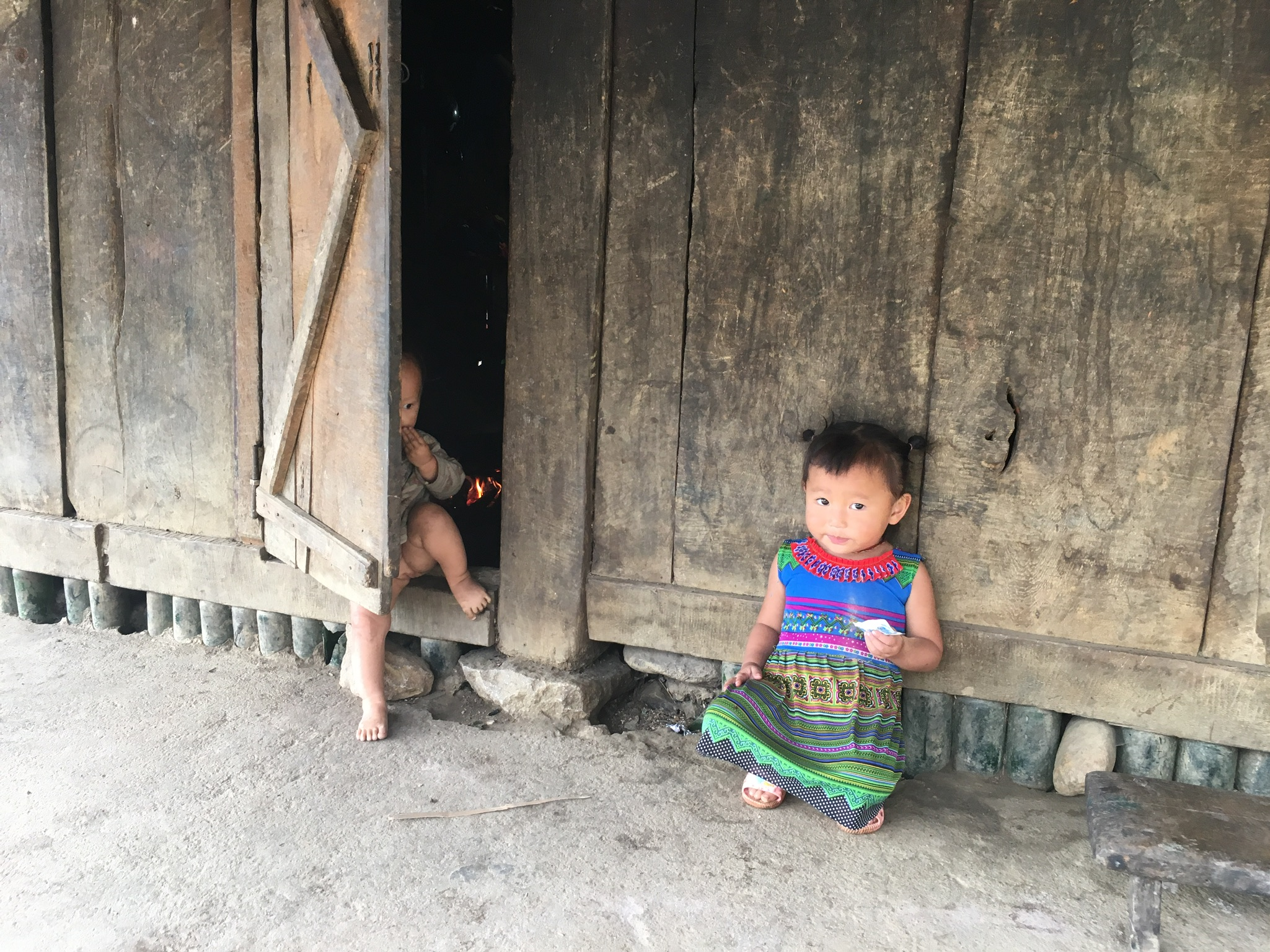 local children on the porch of their home