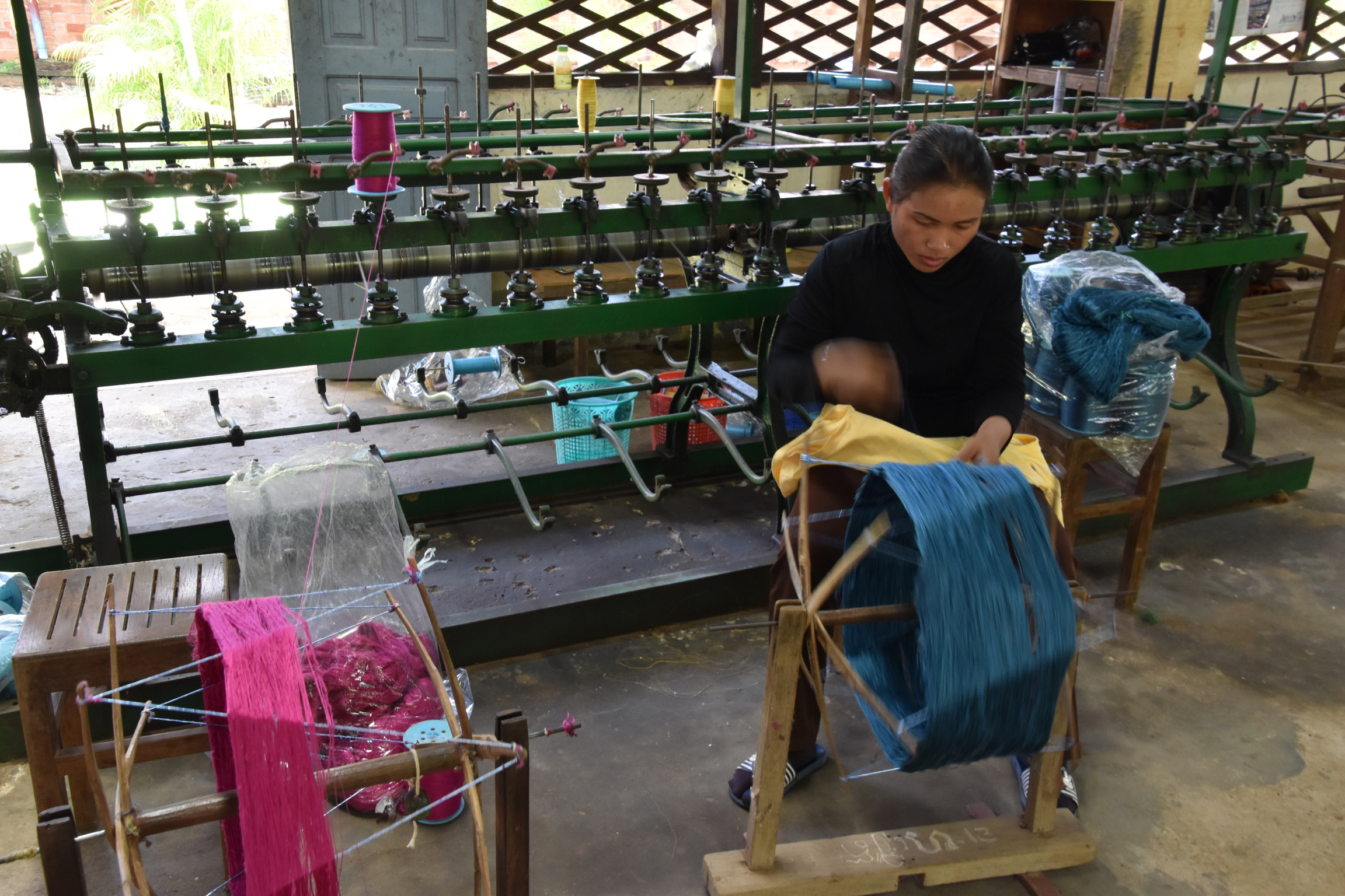 local woman spinning silk