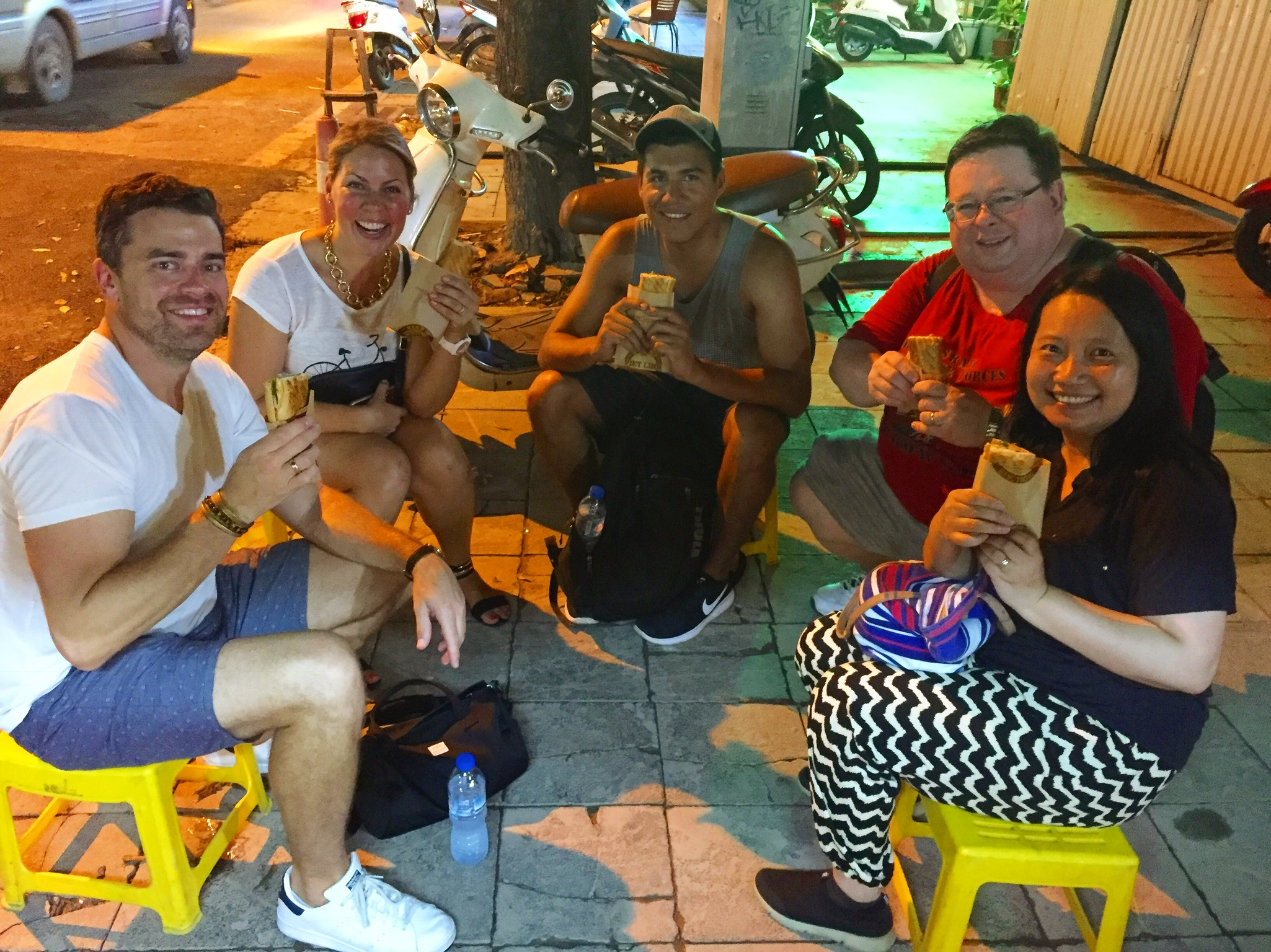 the gang from our Street Food Tour enjoying Bahn Mi (pork sandwich)