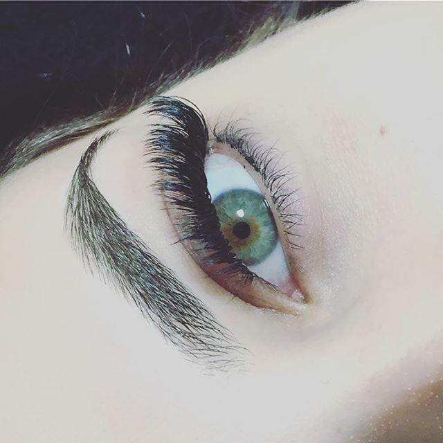 A gorgeous green with a dark black lash