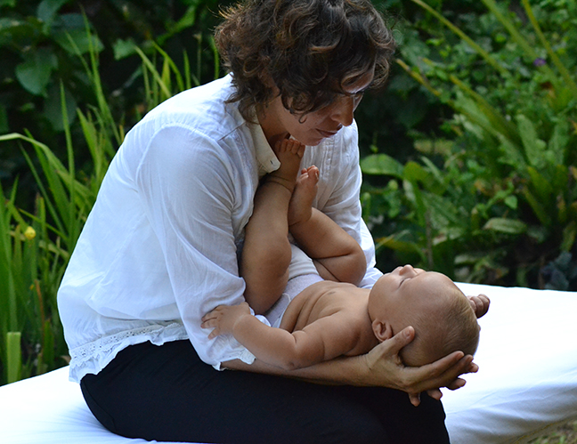 Osteopath with baby