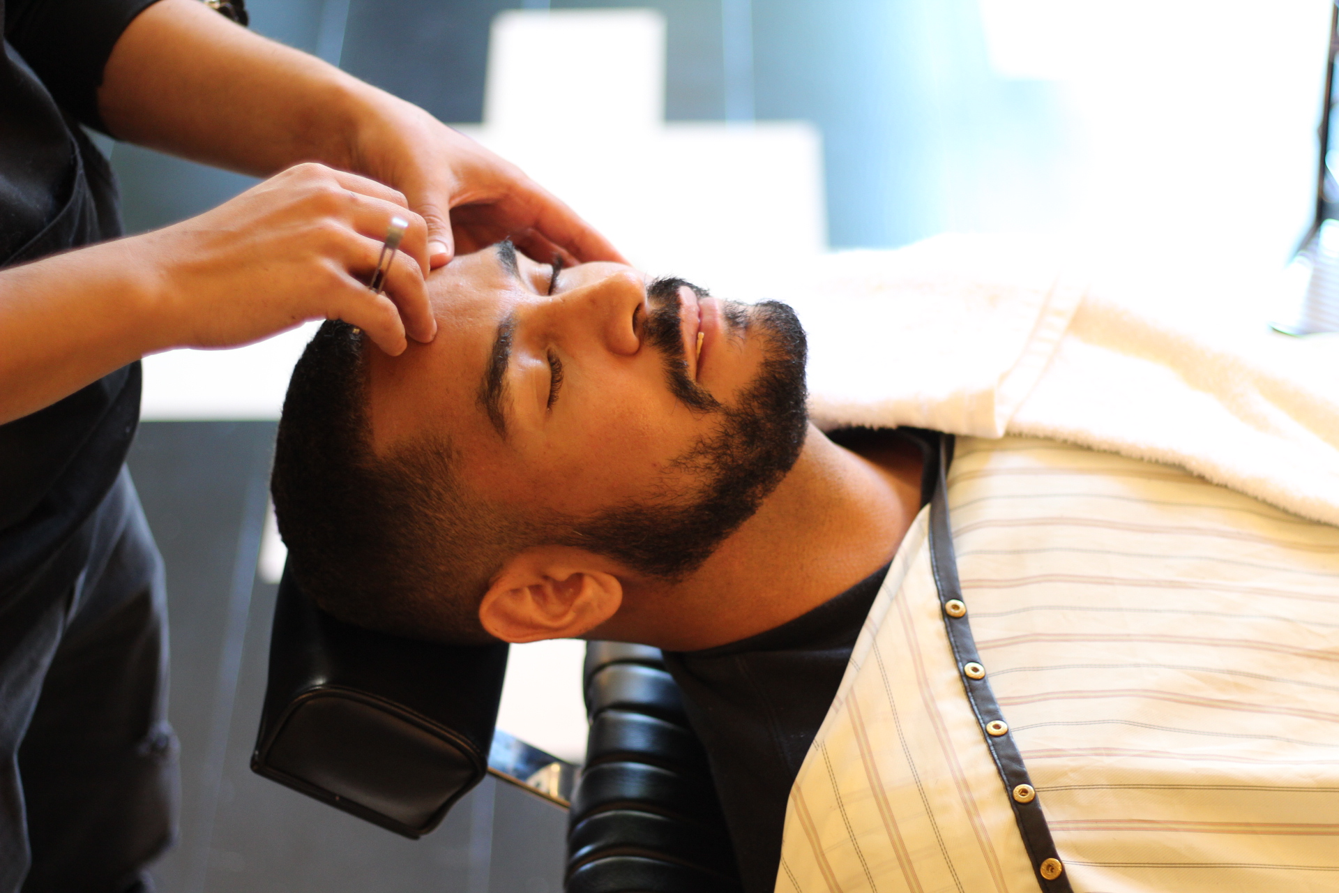 Church Beard Trim  - The Church beard trim is finished with a straight-razor and includes a series of hold and cold compresses using towels dipped in precious essential oils like Neroli and Rose.