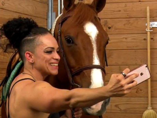 Veteran Lucy Caba with a horse at the Texas Horse Park southeast of downtown Dallas where the therapy offered at a non-profit called Equest includes a program called Hooves for Heroes.
