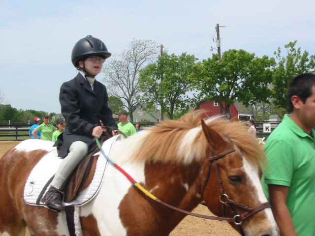 Samantha and her therapy horse, Crunchie, at Special Olympics in 2011