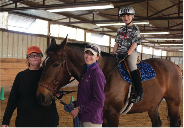 Carson during class with Volunteer Fran Cox and Instructor Shelby Nicoletti