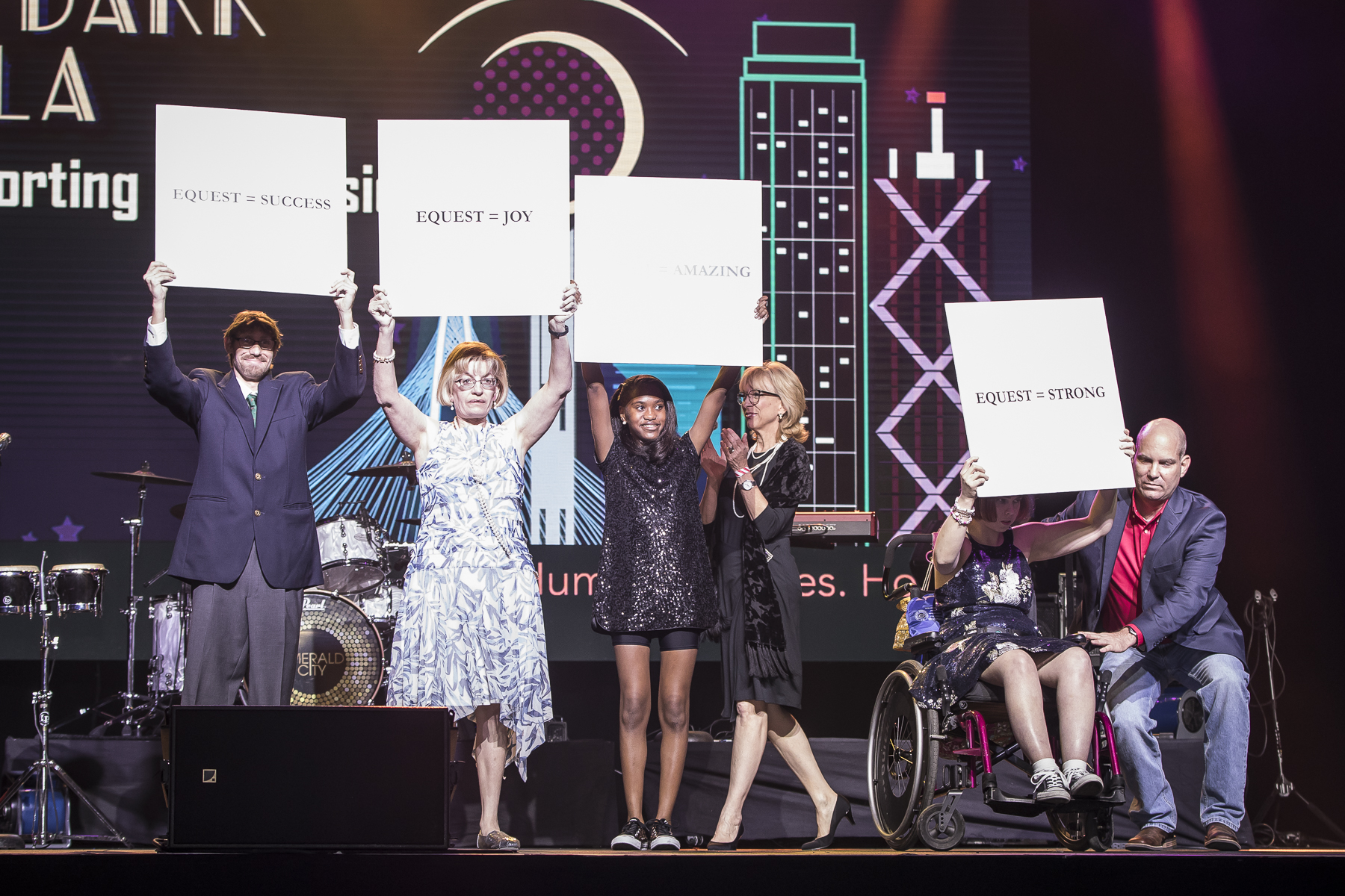 Equest Clients Ryan Wolf, Stacey Johnson, Sandra Hayes, Nancy Appelman, and Joe Lucido take the stage during the 2018 Equest After Dark Gala alongside Equest Director of Development Christine Volkmer. Photo credit Thomas Garza.