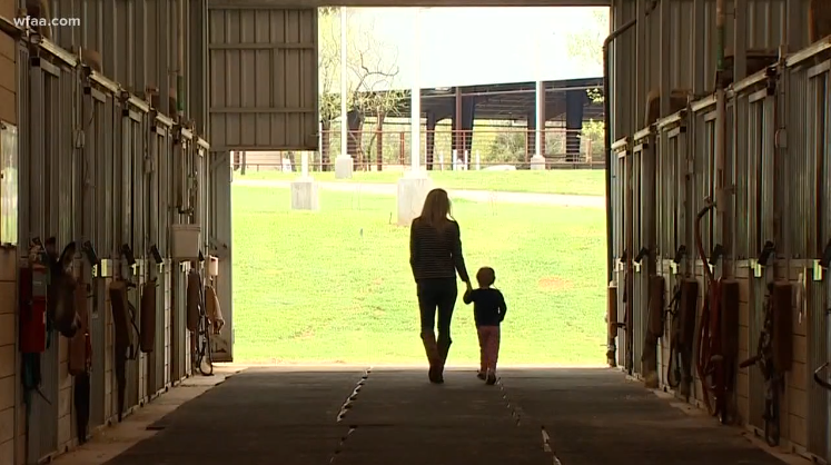 Bliss and her mom in the Equest barn