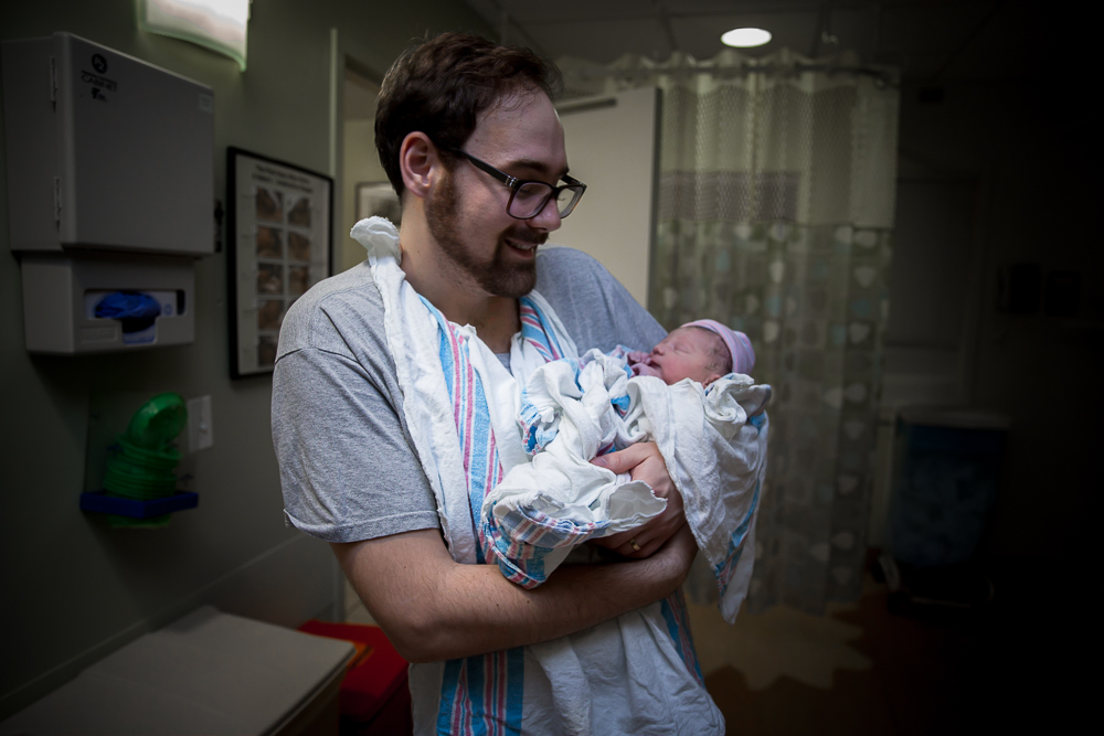 baby-held-by-dad-first-time.jpg