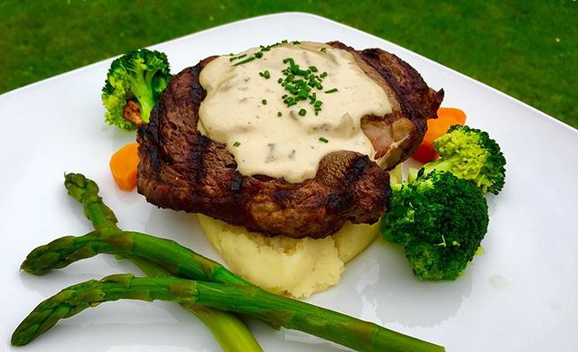 Tender Ribeye on mash with creamy mushroom sauce and seasonal veg.