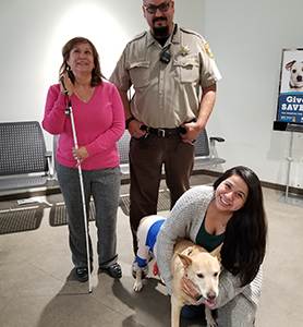 Officer Robledo with Birdy and her family.