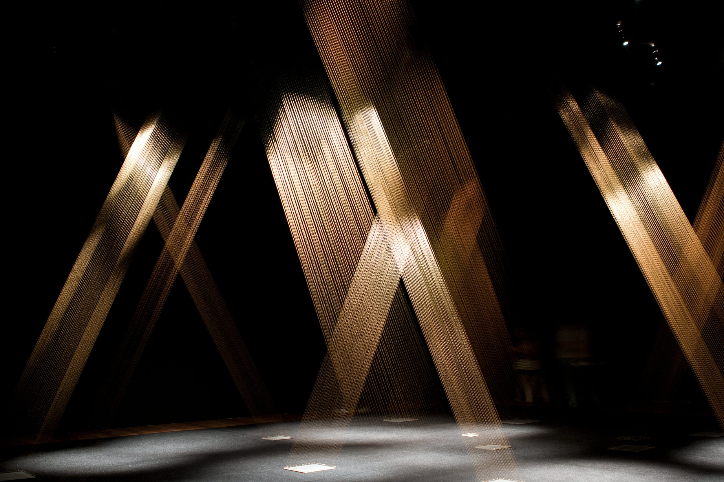 Lygia Pape (Brazilian, 1927–2004) Ttéia 1, C 1976-2004 Dimensions variable Installation View, Serpentine Gallery, London, 2011 Golden thread, nails, wood, light Photo: Paula Pape © Projeto Lygia Pape