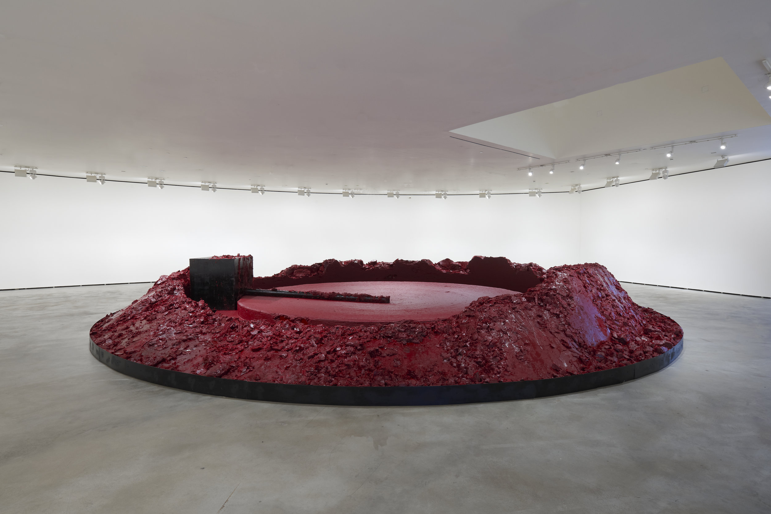 Anish Kapoor My Red Homeland, 2003 Wax, oil-based paint, motor, and steel  Diameter: 12 m, height variableEdition 1/1, 1 A.P. Guggenheim Abu Dhabi  © Anish Kapoor, Courtesy Lisson Gallery  Photo: Dave Morgan