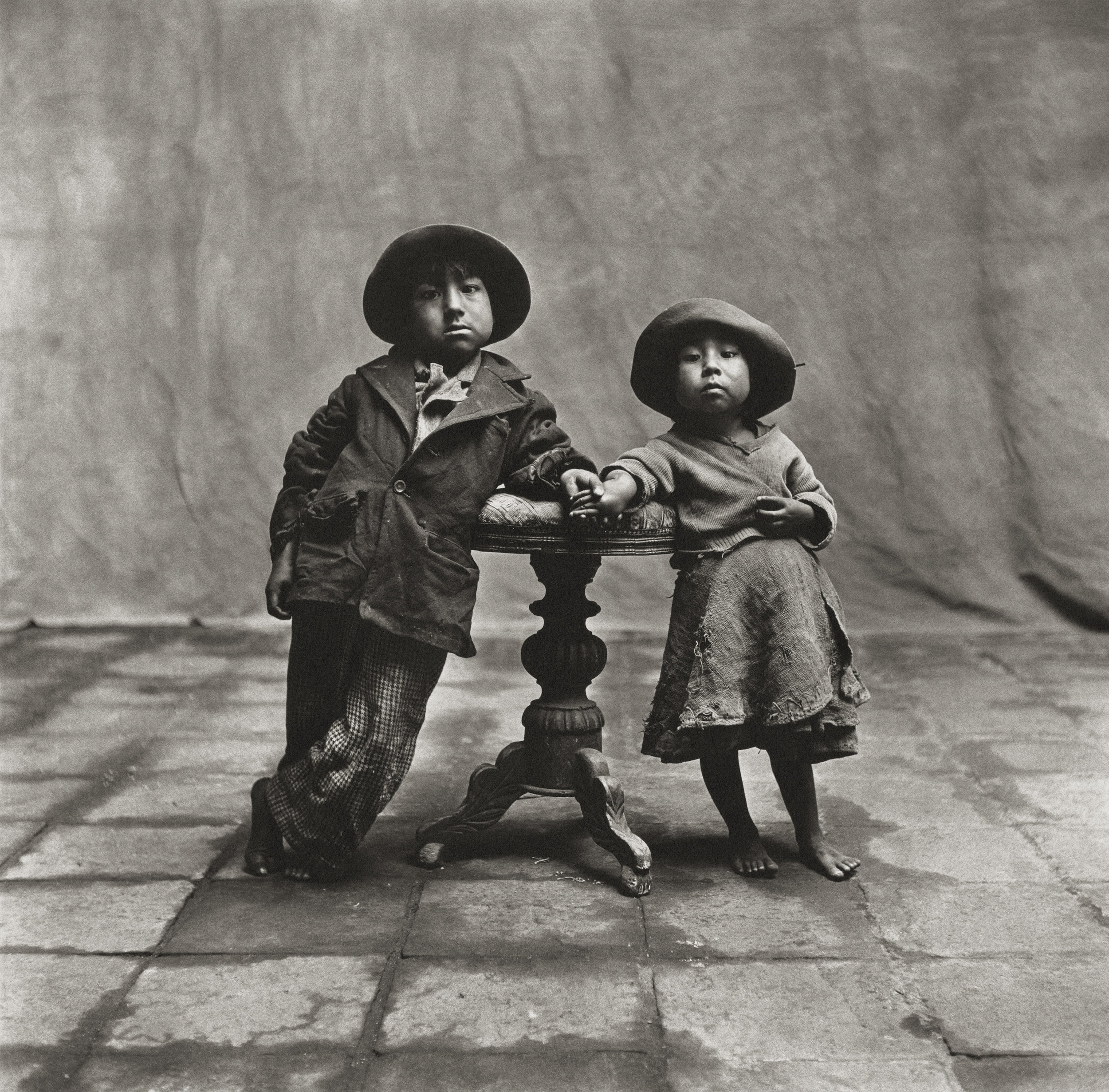 Irving Penn (American, 1917–2009)    Cuzco Children , 1948    Platinum-palladium print, 1968  19 ½ × 19 ⅞ in. (49.5 × 50.5 cm)  The Metropolitan Museum of Art, New York  Promised Gift of The Irving Penn Foundation  © Condé Nast
