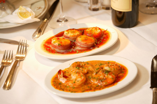 Pancetta wrapped scallops and BBQ Shrimp appetizers.