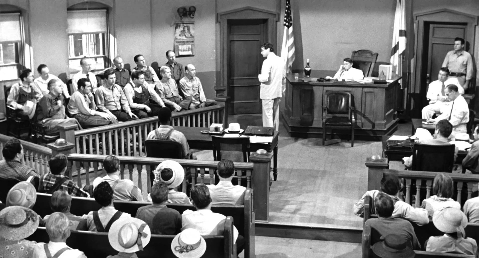 Gregory Peck as Atticus Finch, delivering his closing statement in  To Kill a   Mockingbird , with Paul Fix as Judge John Taylor and Brock Peters as defendant Tom Robinson