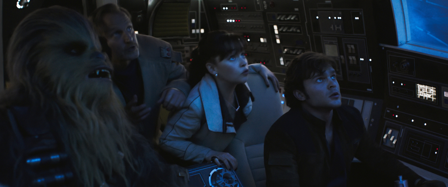 Left to right: Joonas Suotamo, Woody Harrelson, Emilia Clarke, and Alden Ehrenreich aboard the  Millennium Falcon  in  Solo: A Star Wars Story