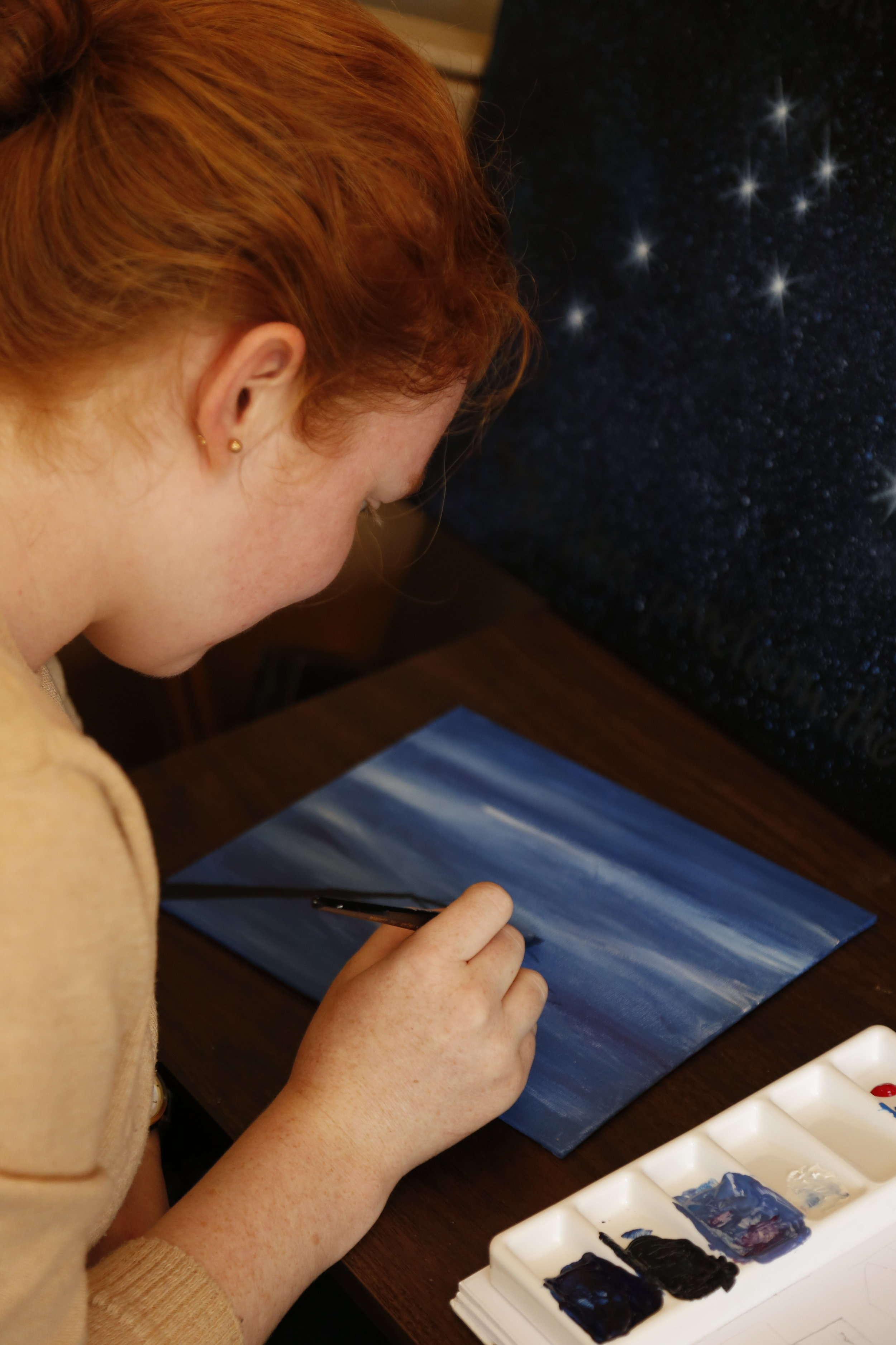 One of my students enjoying painting (to see her finished painting, and other students' work,    click here     )