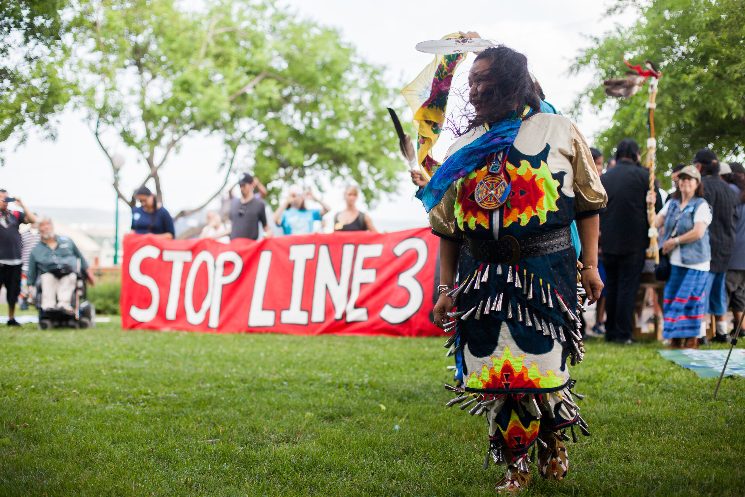 J  uly 13 2017 Indigenous dancers rally outside the St. Paul DEIS hearing.  Photo by Jaida Grey Eagle