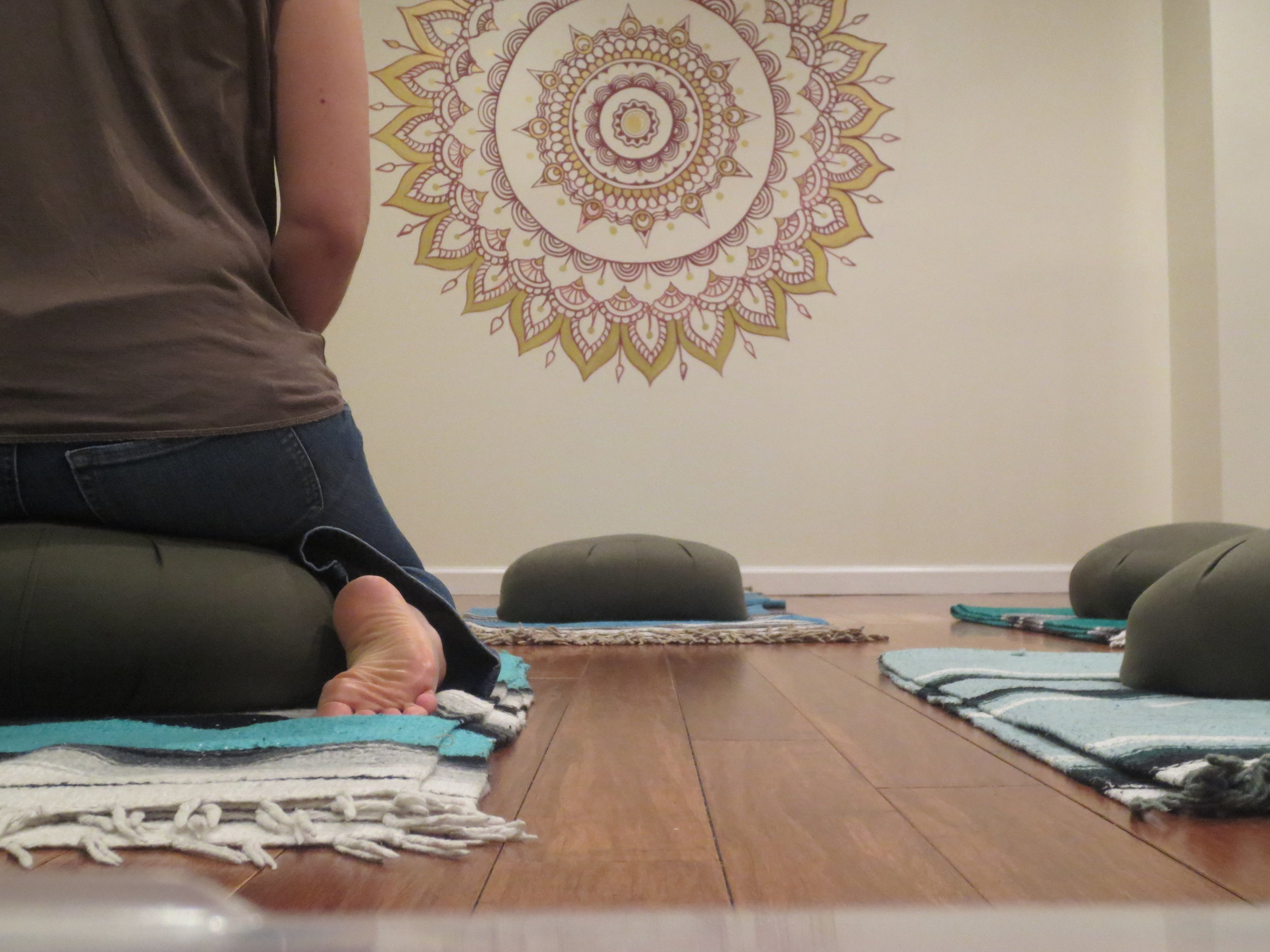 A student ready for guided meditation at our studio.