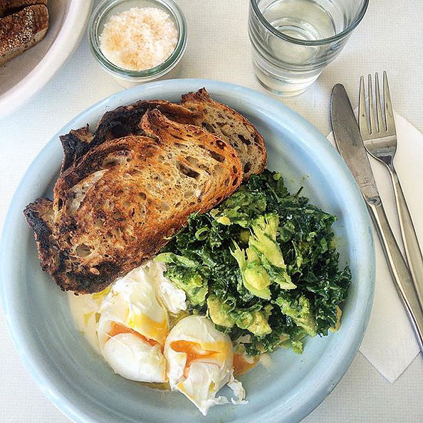 Pictured: Multigrain toast, poached eggs and smashed avo