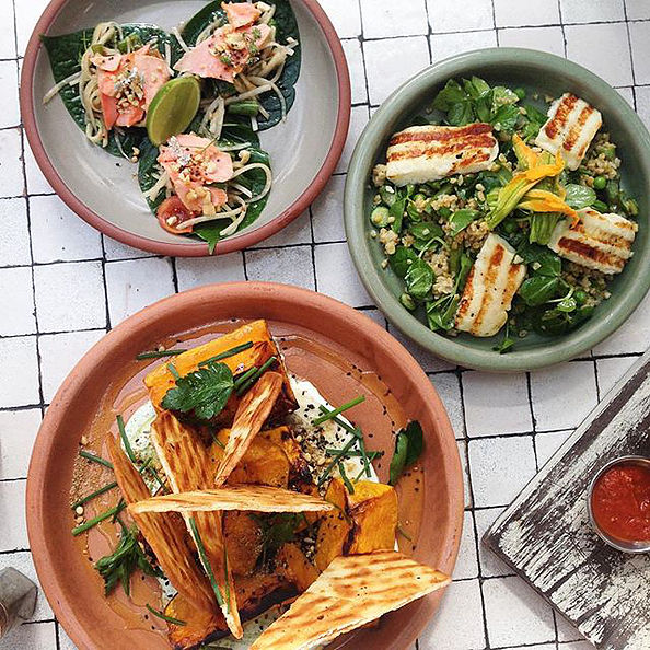 Pictured: Fish tacos, Haloumi and freekeh salad and baked pumpkin