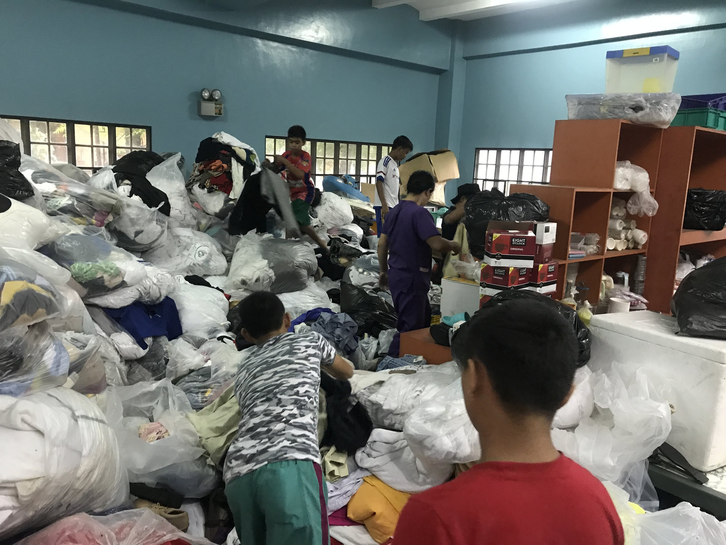 Tuloy kids help in sorting out donations.