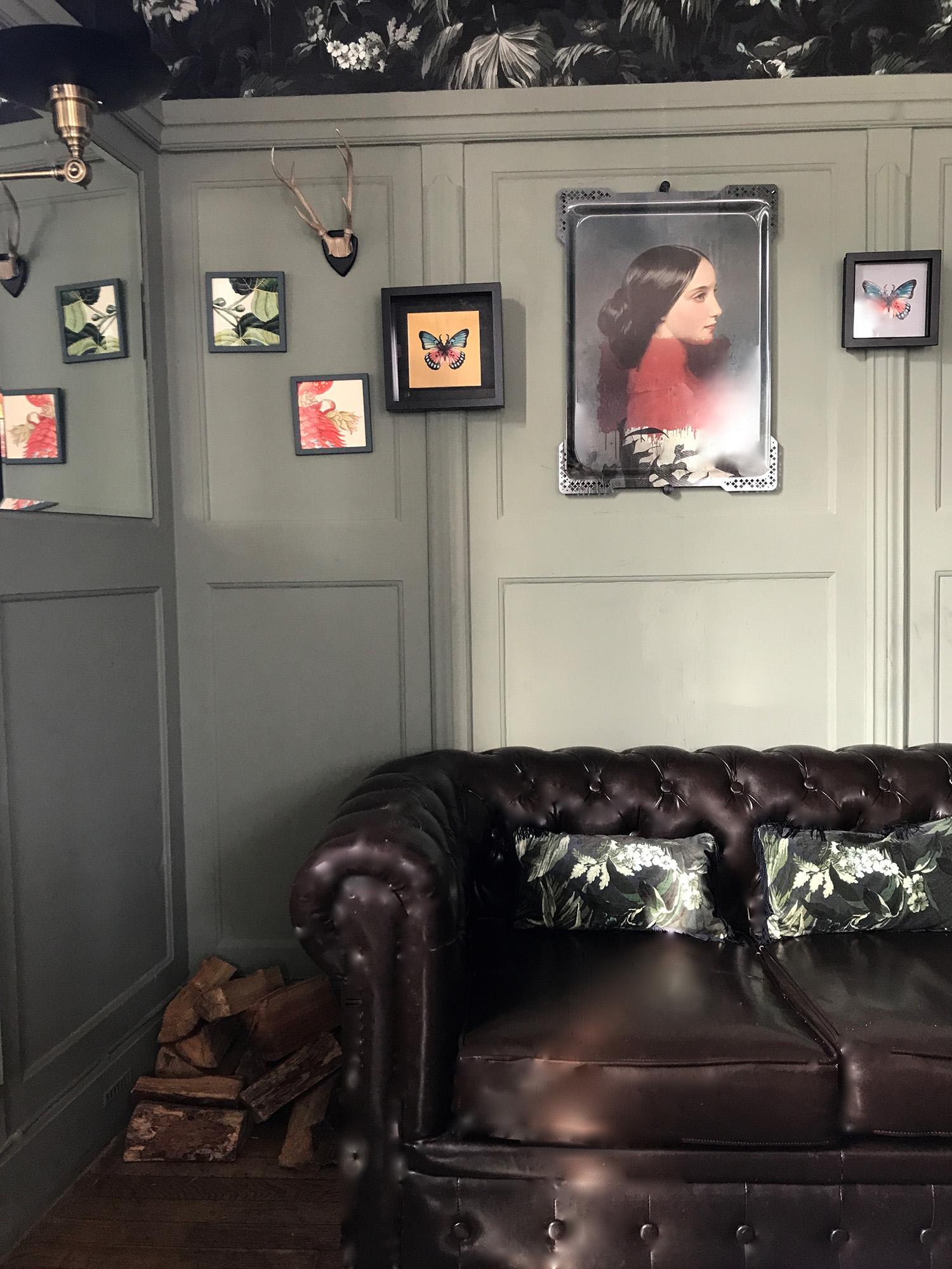 Bumpkins leather sofa and paintings.jpg