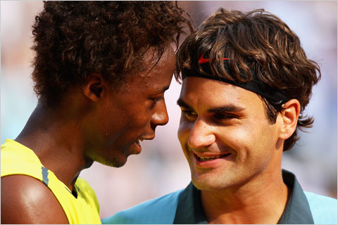 Gael Monfils (left) Roger Federer (right) at 2009 Men's Singles Quarter Final French Open at Roland Garros in Paris, France. Photo by: Ryan Pierse/Getty Images Europe