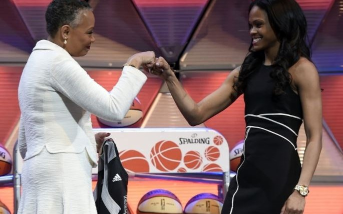 Lisa Borders fist-bumps second overall pick Moriah Jefferson during WNBA Draft. The Day/Sean D. Elliot