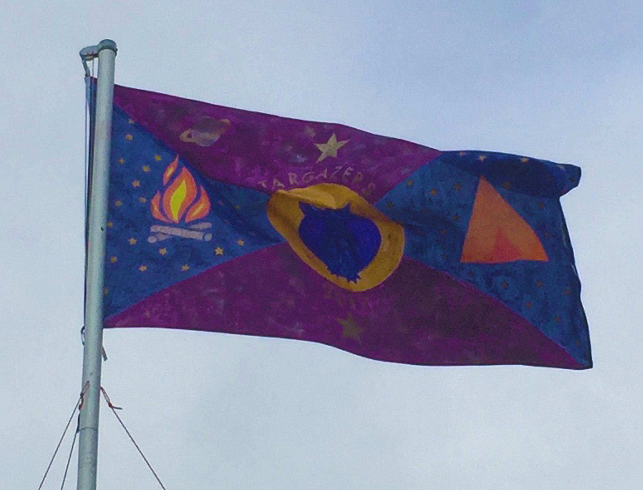 The opening ceremony includes raising the decorated camp flag!