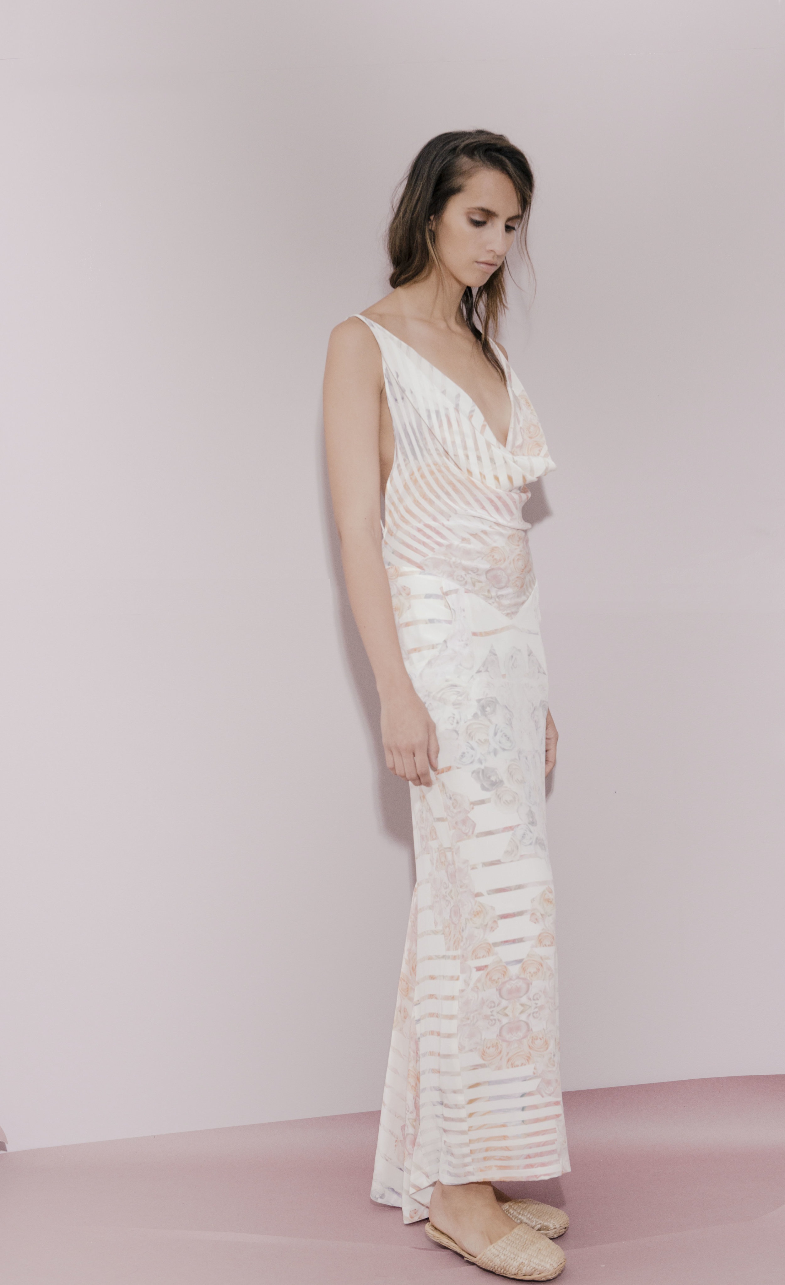 STARFLOWER GOWN  Flower printed ivory silk crepe cowl draped open back gown. Price upon request.