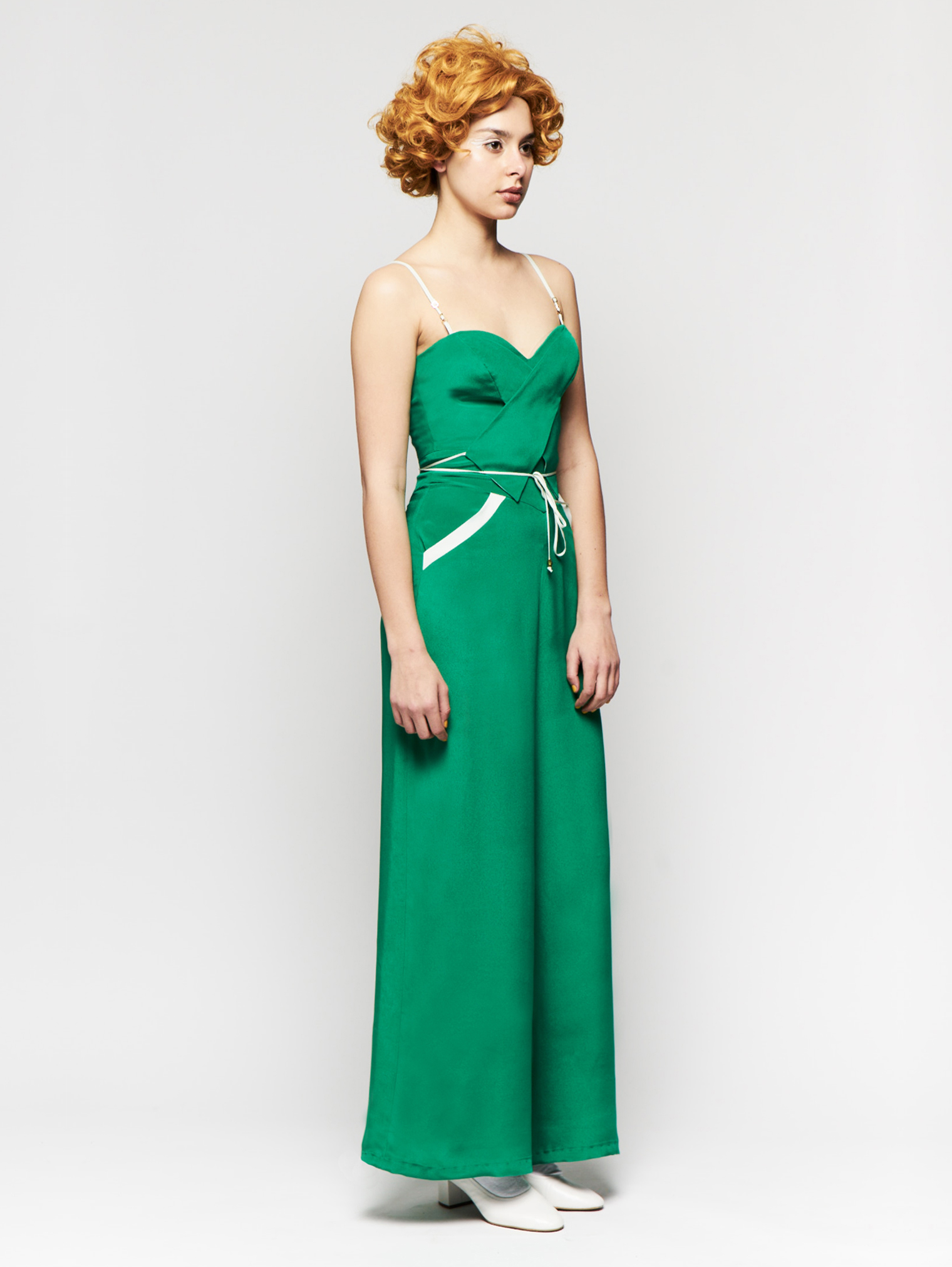 ANNULUS JUMPER  Emerald silk crepe spaghetti strap jumper with pockets. Price upon request.
