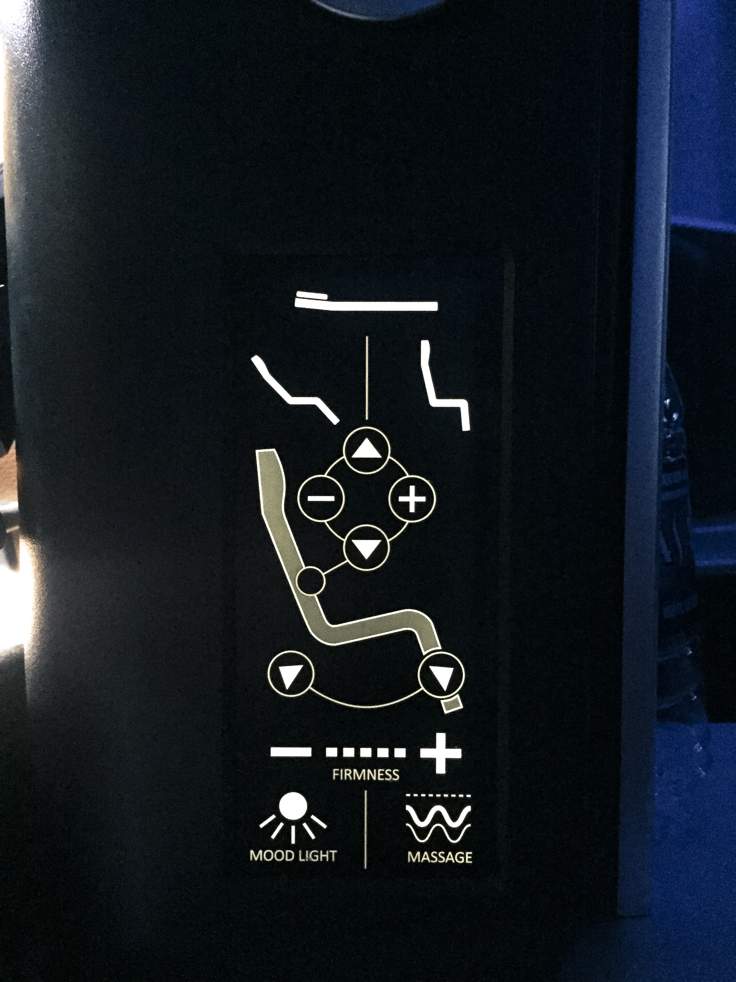 Seat controls, including airbag firmness adjustment.