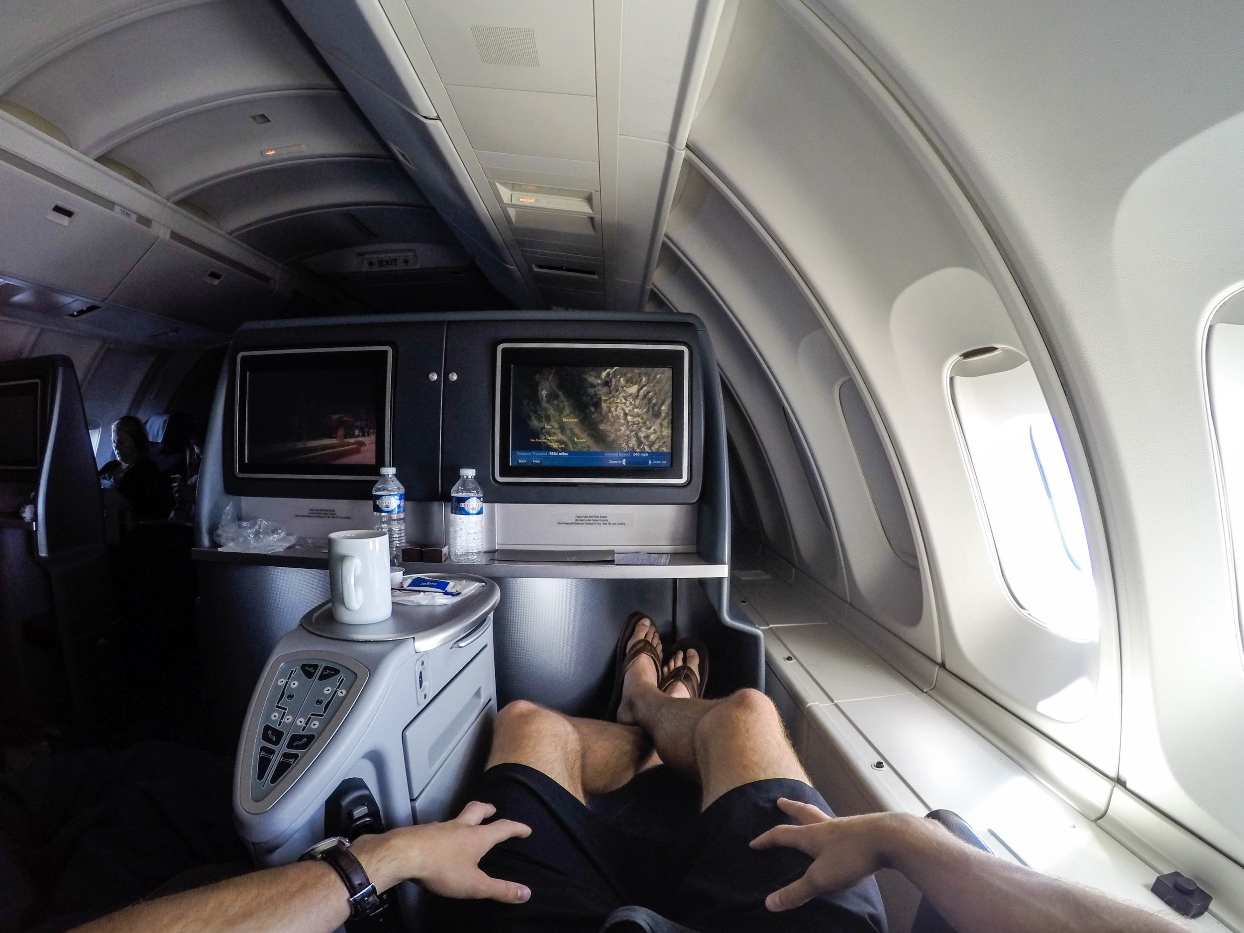 """Legroom was good though and when the seat is flat, the bins serve as additional """"bed"""" space, which was nice."""