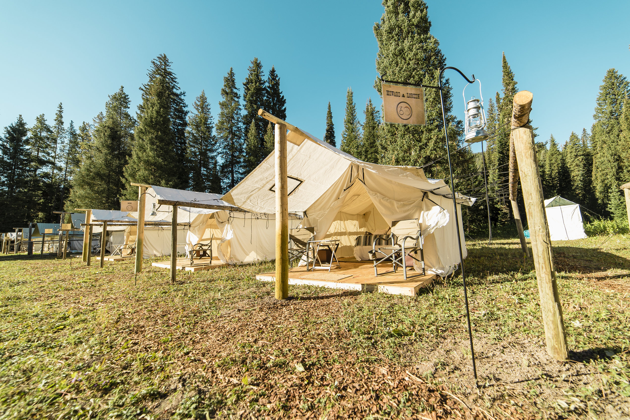 The incredible tents set up for each guest at the camp. Bath houses seen in the background.