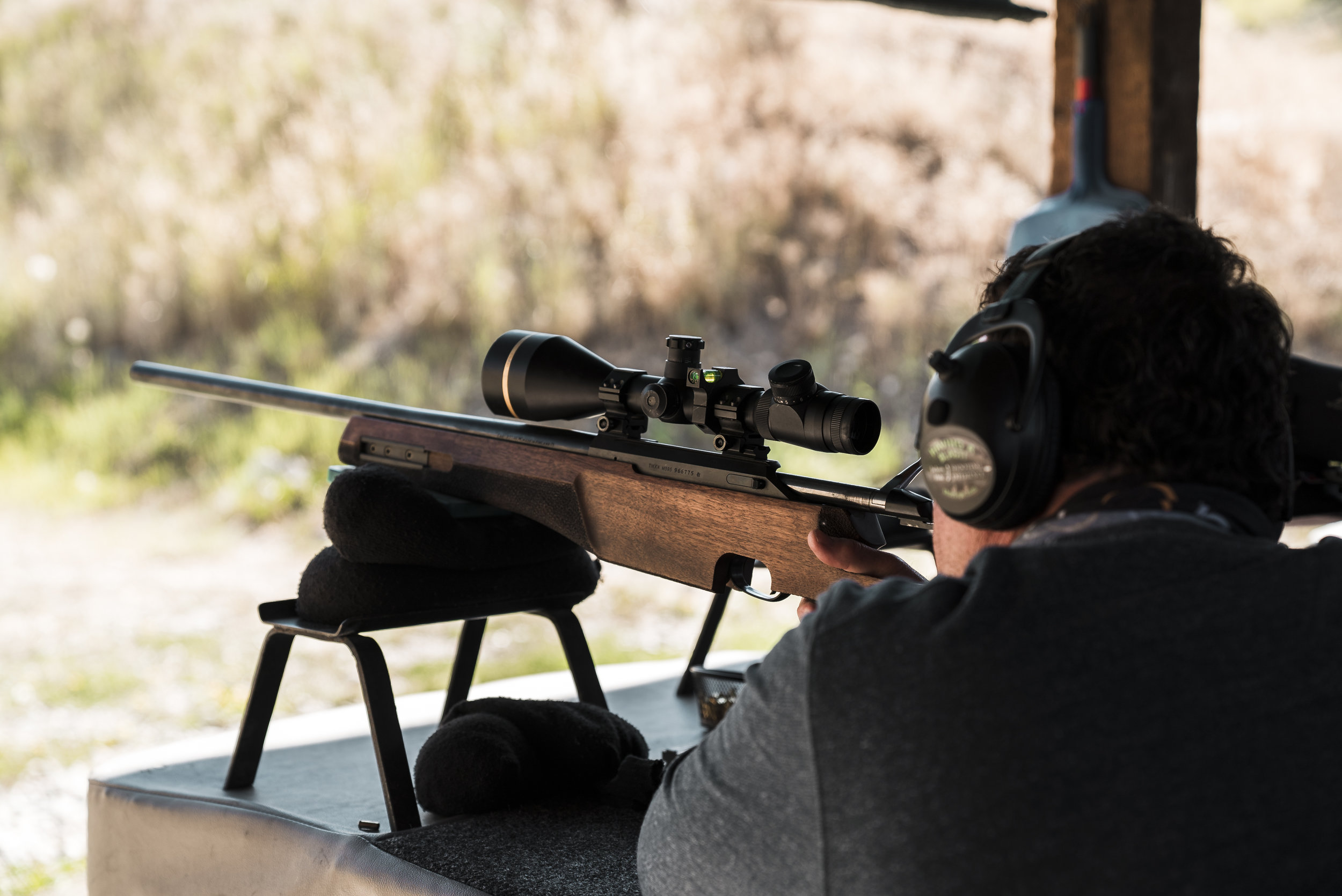 Firing a rifle during a VIP shooting experience at the gun range in Jackson HOle