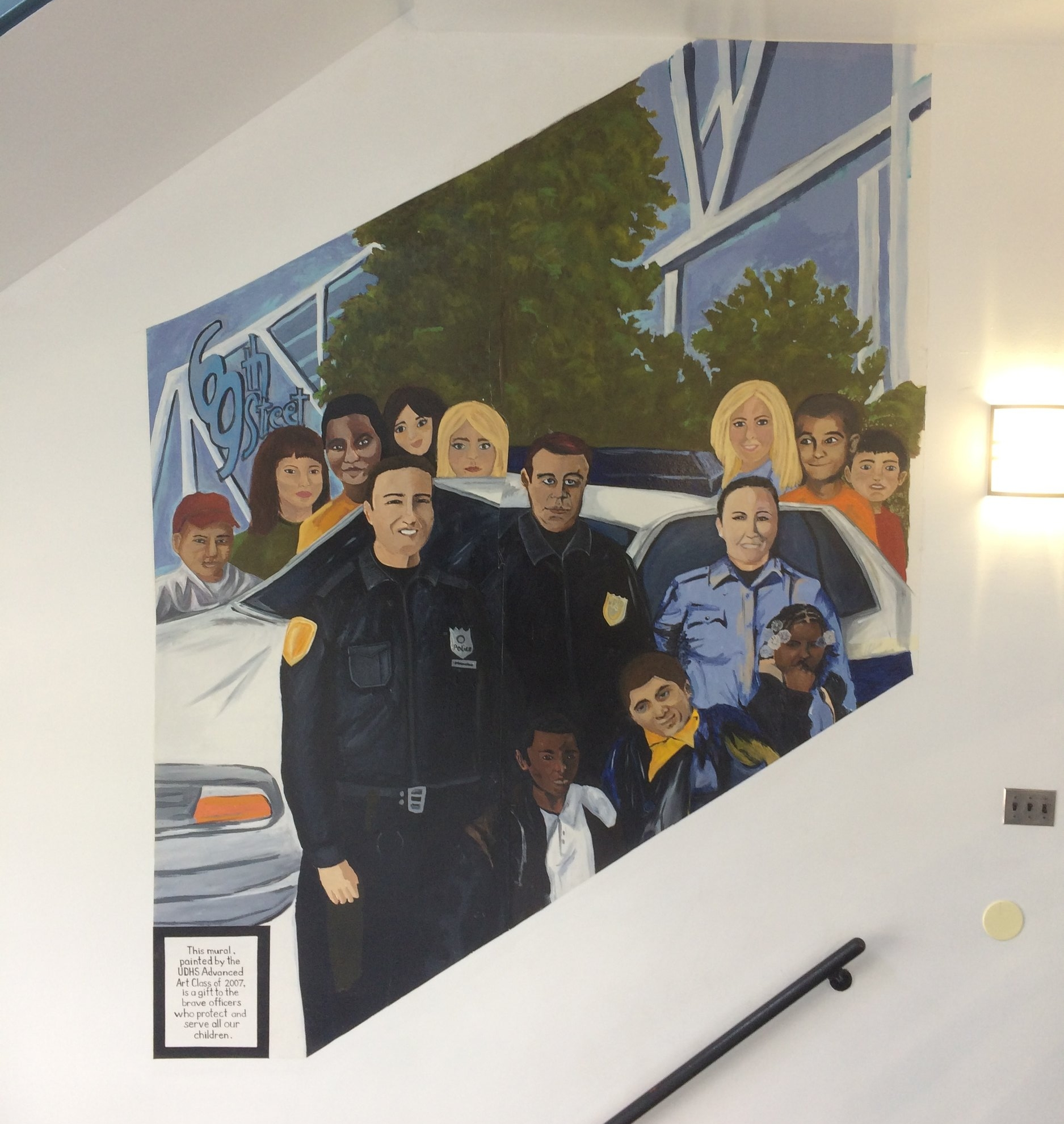 Mural of officers and youth painted by young residents of Upper Darby (photo by Mitchell Bloom)