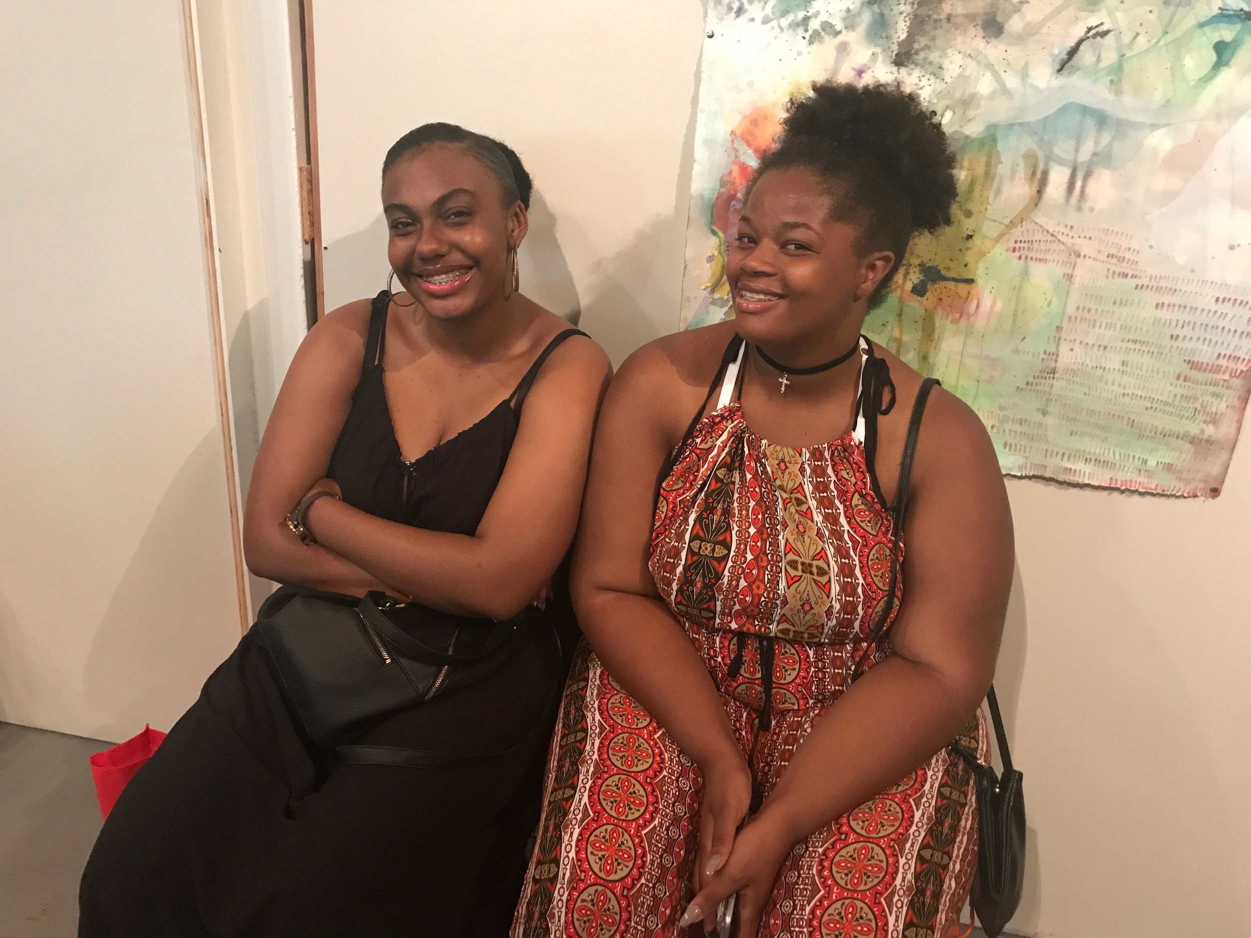 Trinity, left, with fellow intern Brittany at the Kitchen Table Gallery