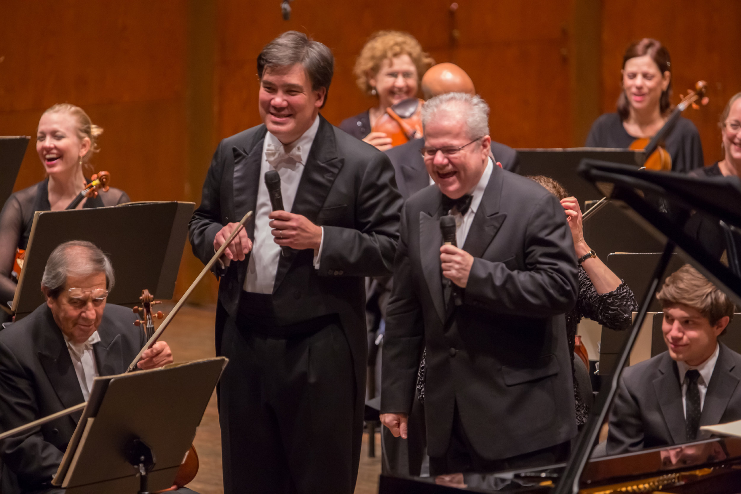 Pianist Emanuel Ax served as Artist-in-Residence (2012–13) after being named an Honorary Member of the Philharmonic-Symphony Society of New York on the occasion of his 100th performance with the Orchestra. He performed concertos by J.S. Bach, Schoenberg, and Mozart; reprised Composer-in-Residence Christopher Rouse's  Seeing,  a Philharmonic commission, which the pianist and the Orchestra had premiered in 1999; and traveled on the Orchestra's Europe tour.