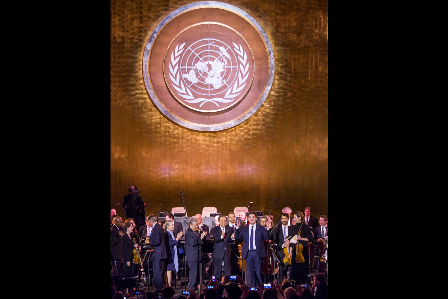 """Secretary-General Ban Ki-moon and Secretary-General-Designate António Guterres were among those who joined Alan Gilbert and the Orchestra onstage at the U.N. concert. """"I am extremely grateful to Mr. Gilbert and the New York Philharmonic for offering a concert in celebration of the work of the United Nations over the past decade,"""" Ban Ki-moon had said when the concert was announced, adding that he welcomed """"this globally renowned orchestra for this very special event which underscores the power of music to inspire and unite."""""""