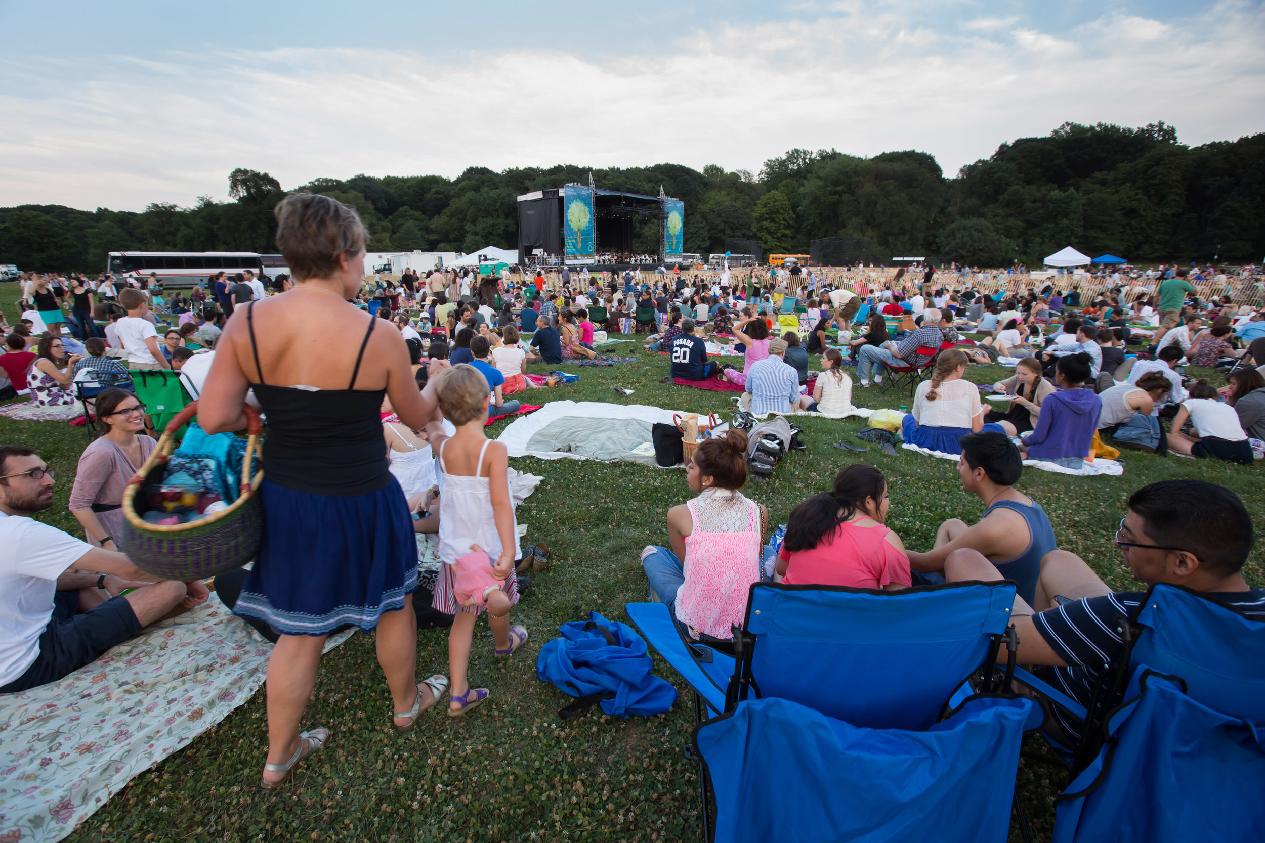 Alan Gilbert made the Concerts in the Parks a regular feature of his summer schedule to the delight of New Yorkers and visitors to the city, who flocked to the parks (including Brooklyn's Prospect Park, seen here in 2012) to hear him and the Philharmonic perform priceless music, absolutely free — and to picnic, enjoy fireworks, and catch a rare glimpse of the stars.