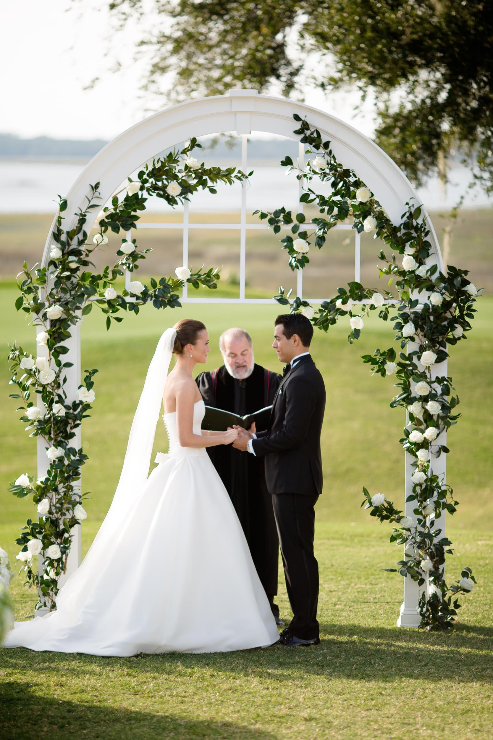 Floral wedding ceremony arch for Kiawah Island wedding.