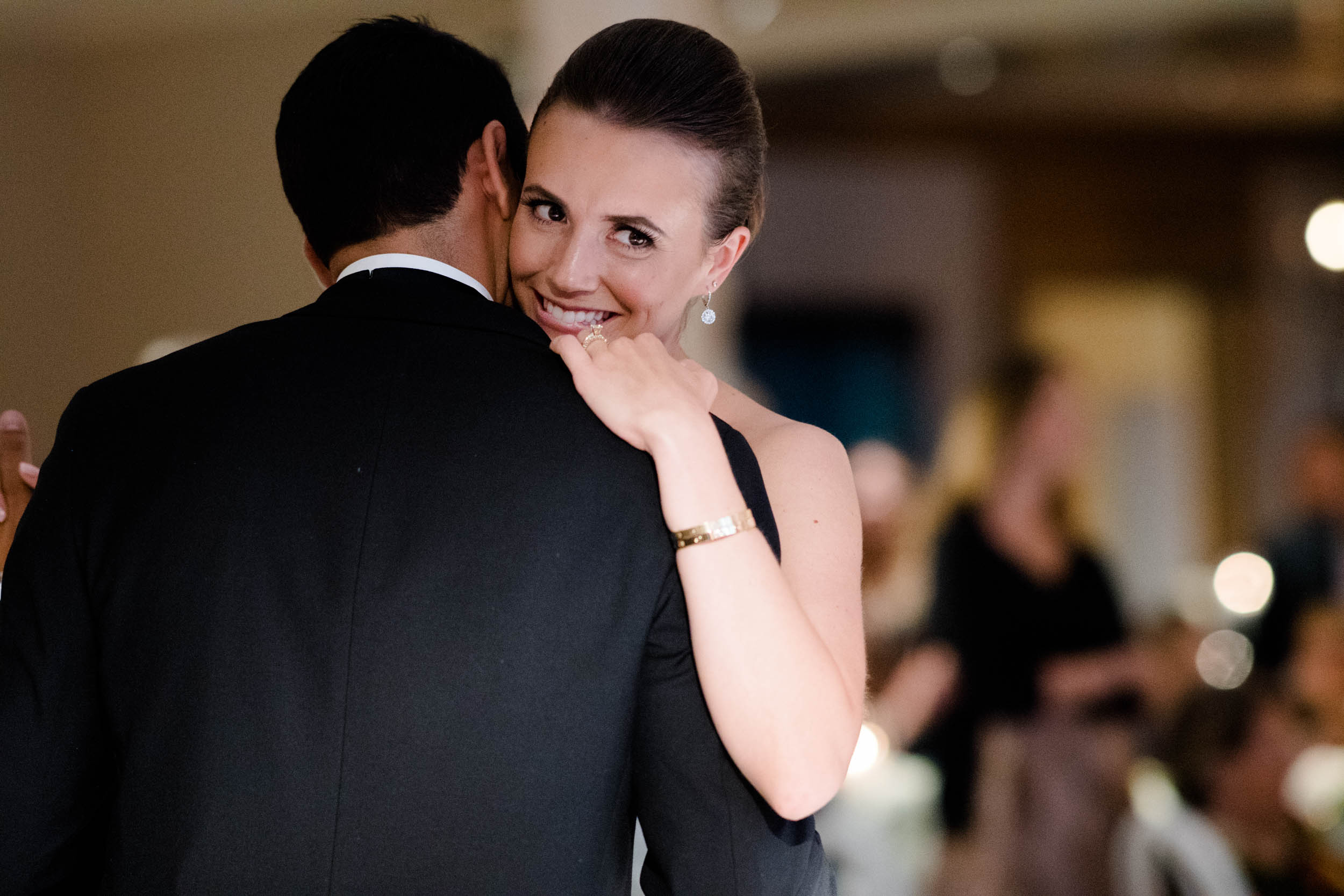 Candid photo of the bride and groom during their first dance in Charleston, South Carolina.