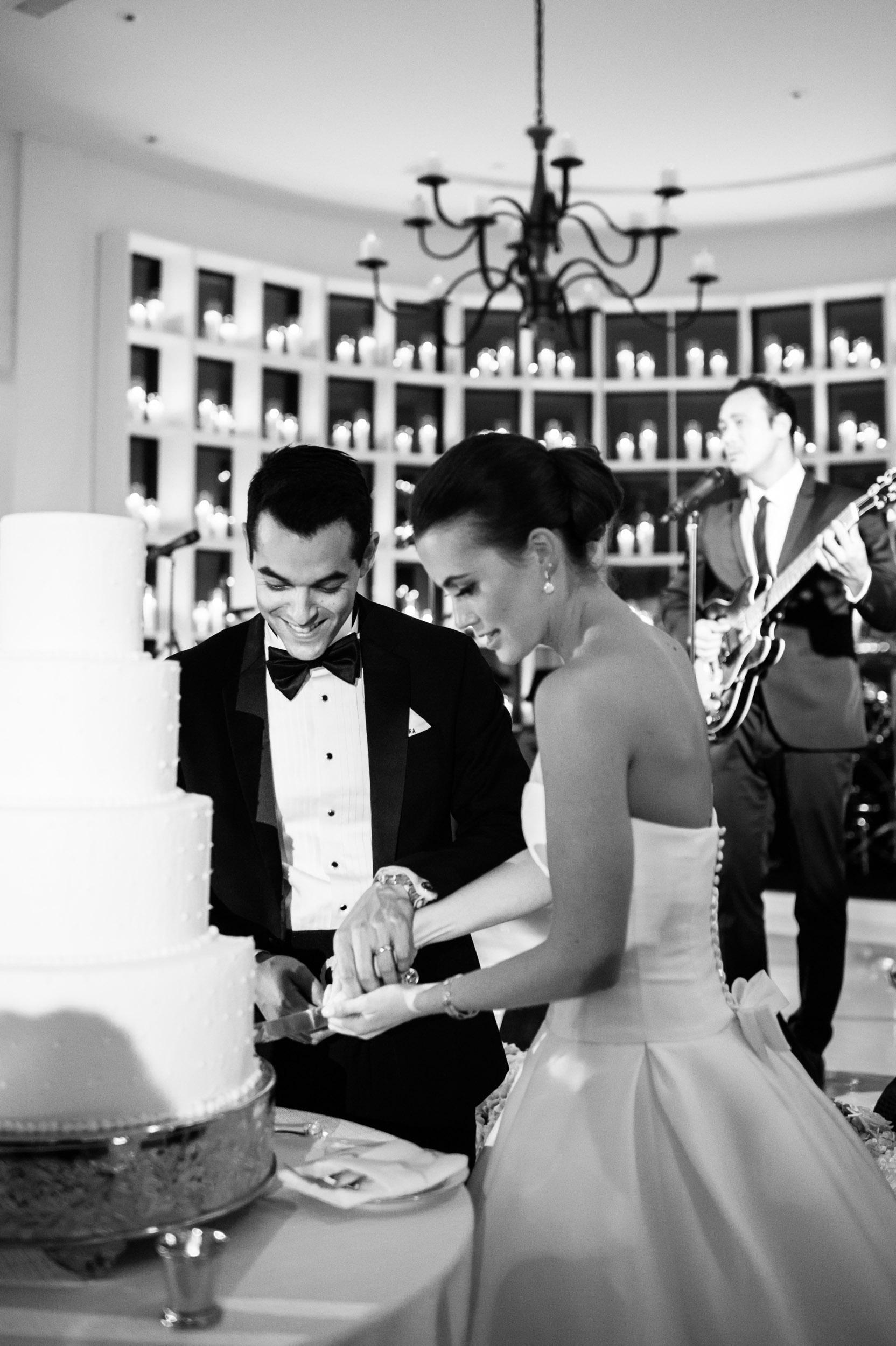 Bride and groom cut the cake at their wedding reception in Kiawah Island, South Carolina.