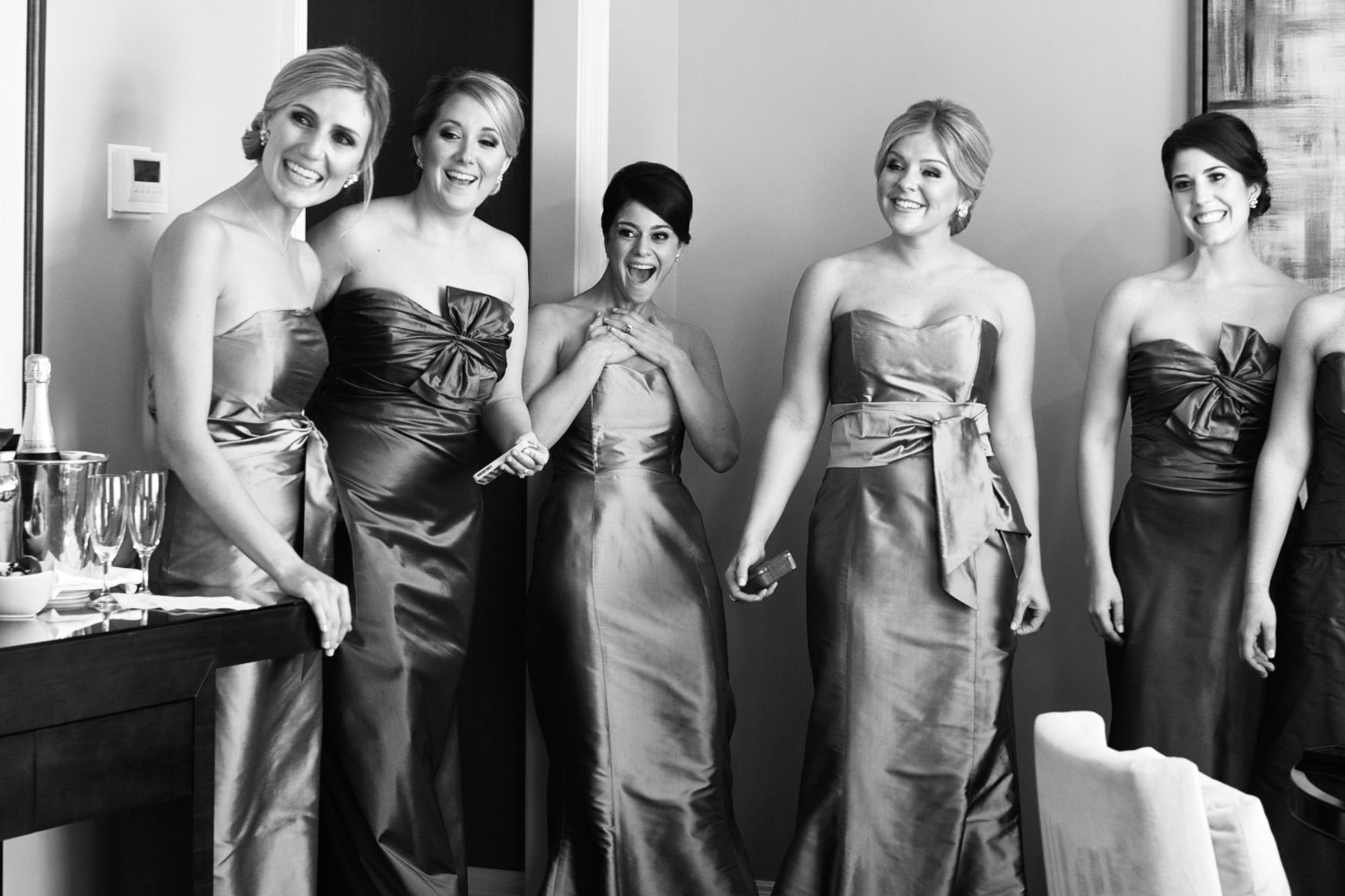 Bridesmaids see bride for the first time at wedding at the Four Seasons Chicago.